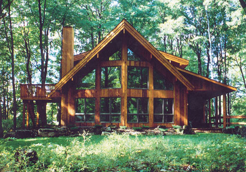 Woodland post and beam retreats cottages home plans for Maine post and beam kits